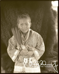 American-Indian-boy-holding-eagle-feathers
