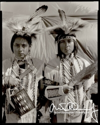 Twin-American-Indian-Boys-Holding-Hatchet-and-Eagle-Feathers